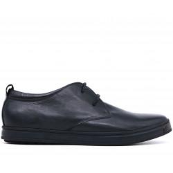Черные кожаные демисезонные кеды